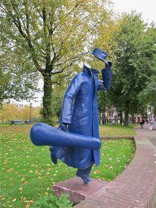 Sculpture of Running man with violin case